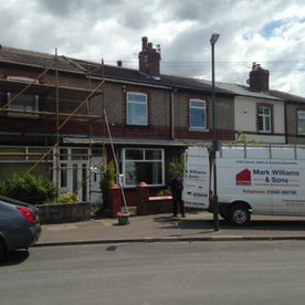 company van and scaffolding on home